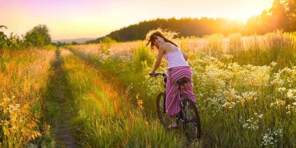 full vitality woman on bike happy
